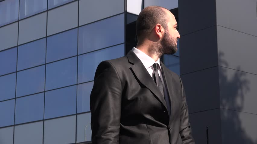 Positive cheerful happy businessman outdoors stylish urban entrepreneur smiling | Shutterstock HD Video #30715846