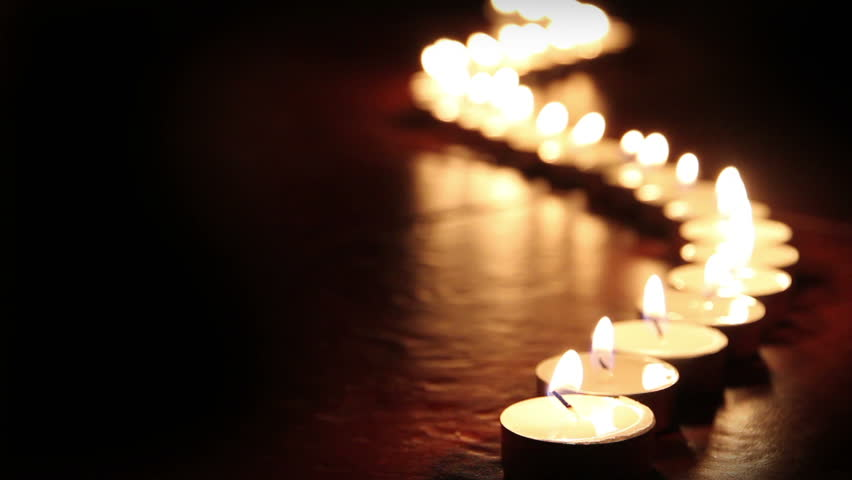 Candlelight. Little candles lined up light up one by one