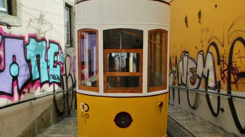 Lisbon, Portugal - August 26, 2017: Hyperlapse POV of Bica funicolar intersection. Ascensor da Bica is Lisbon most picturesque funicular, leading up to Bairro Alto with scenic views of Tagus River.
