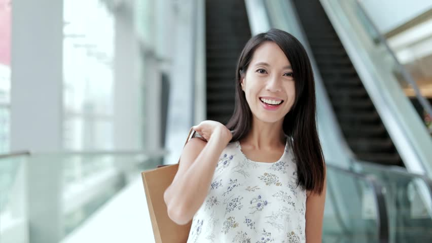 Happy woman holding shopping bags  | Shutterstock HD Video #30796696