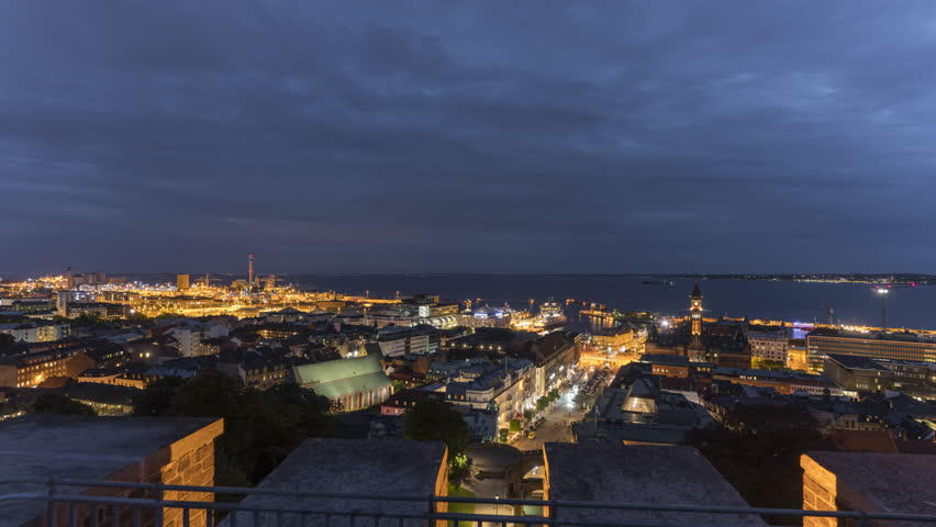Timelapse Panorama View Of Helsingborg at night, Sweden. 4K, 30P