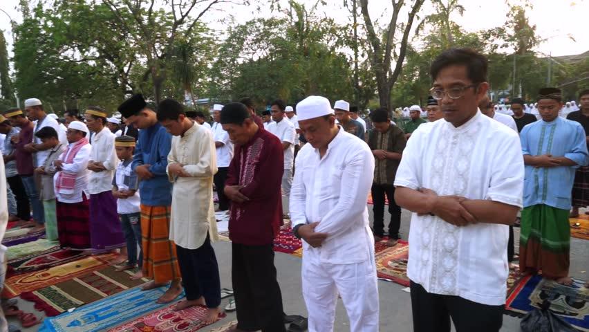 JAKARTA, Indonesia. September 12, 2017: Closeup footage of Male muslims praying together on Eid Al-Adha day at Sunda Kelapa port field | Shutterstock HD Video #30816556