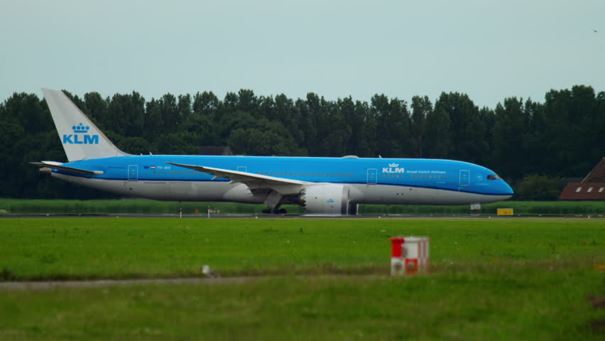 AMSTERDAM, THE NETHERLANDS - JULY 24, 2017: KLM Boeing 787 Dreamliner PH-BHI taxiing and Air Astana Airbus 321 accelerate before departure at RW 36L Polderbaan. Shiphol Airport, Amsterdam, Holland