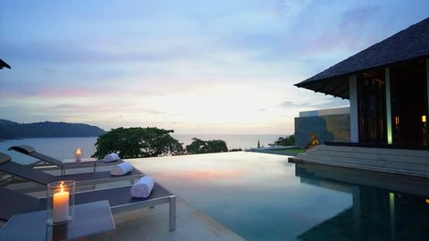 Evening twilight view from luxury pool deck infinity pool