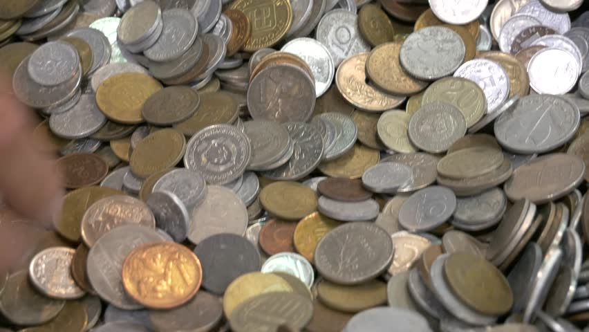 Different coins from around the world - numismatic collector - mammon and the desire for wealth | Shutterstock HD Video #30839386