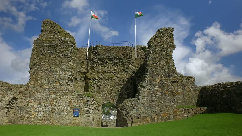 Welsh flags upon an old castle wall.