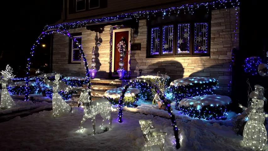 Christmas holiday lights seasons greetings, winter snowfall - Revere, Massachusetts USA - December 17, 2016