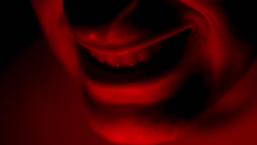 Creepy Weird Red Mouth Illuminated in Dark with Red Light
