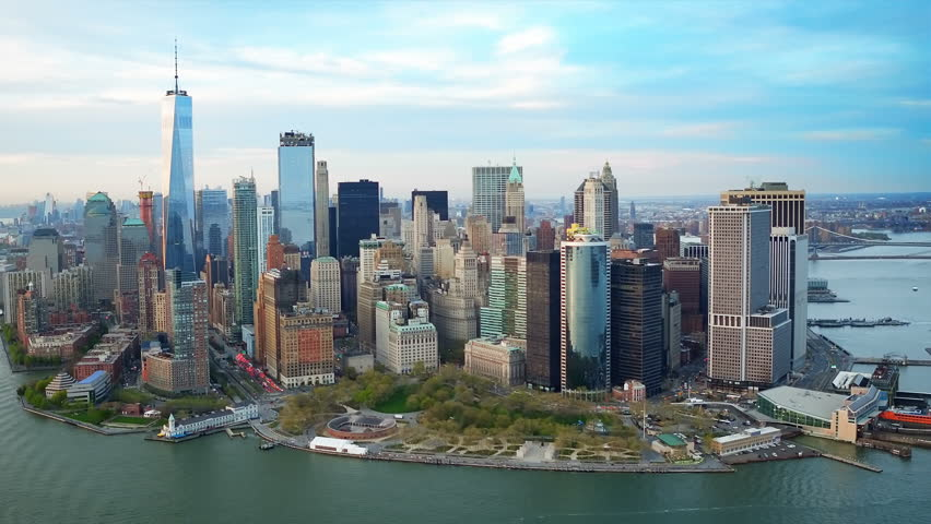 Aerial view of the Financial District in Lower Manhattan. Famous Skyscrapers. Daytime New York City, United States. Shot from a helicopter.