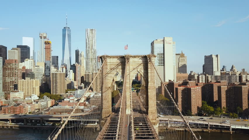 Aerial view of the Brooklyn bridge through the East river to Manhattan district in New York, America. | Shutterstock HD Video #30947086