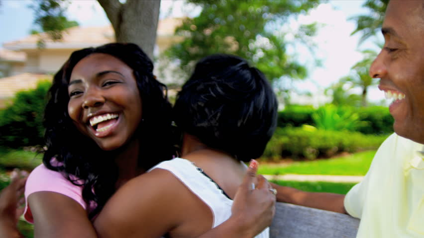 African American Parents Greeting Teenage Daughter