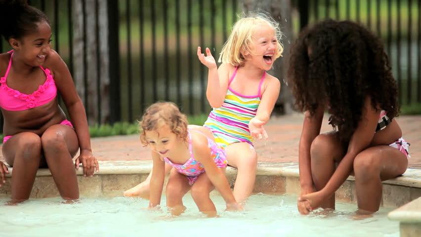 Multi ethnic lucky girlfriends have fun in swimming pool