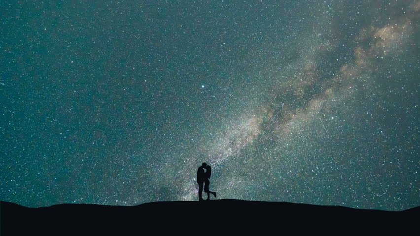 The man and woman kissing on a background of starry sky. time lapse  #30970096