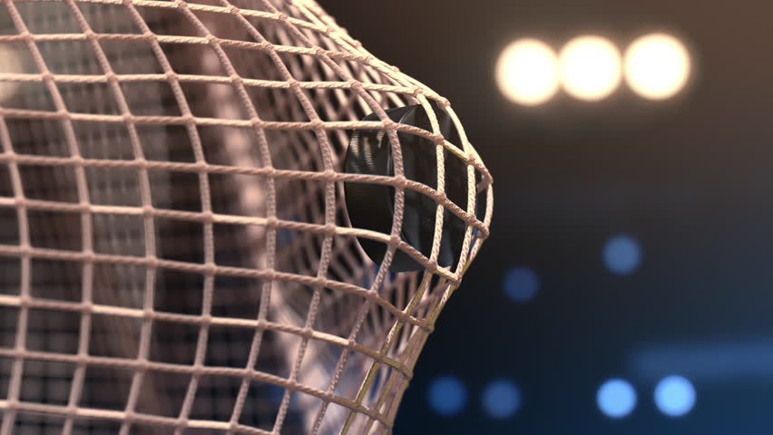Hockey puck flies into the net. Close-up (4k, 3840x2160, ultra high definition)    | Shutterstock Video #30979384