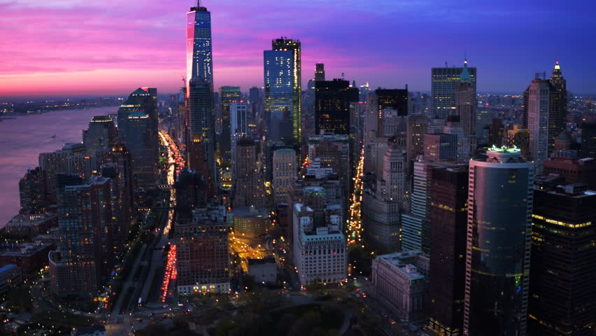 Lower Manhattan skyline and traffic passing by. Famous skyscrapers during sunset in the Financial District of New York City. United States, North America. Shot from a helicopter. | Shutterstock HD Video #30979846