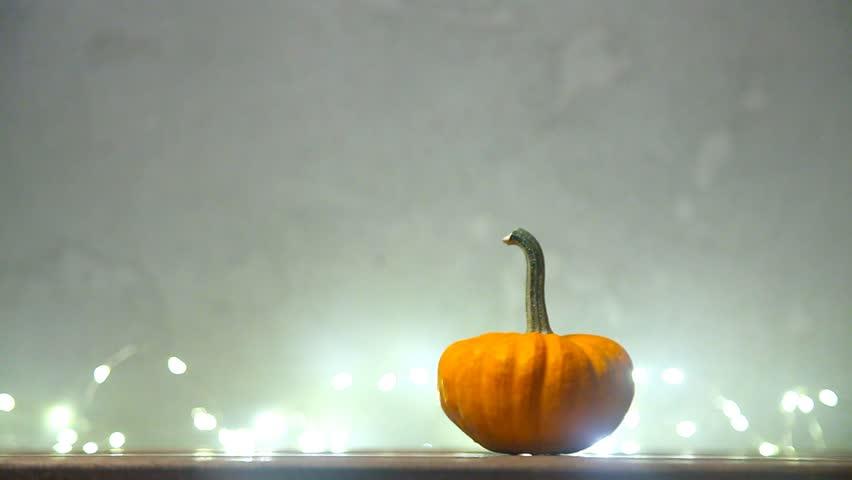 Halloween seasonal pumpkin and Fairy Lights on background   Shutterstock HD Video #31001626