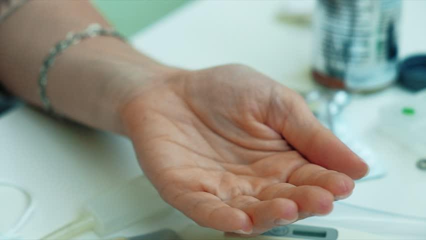 Woman fingering pills in her hand, Tablet in hand, 4k | Shutterstock HD Video #31006456