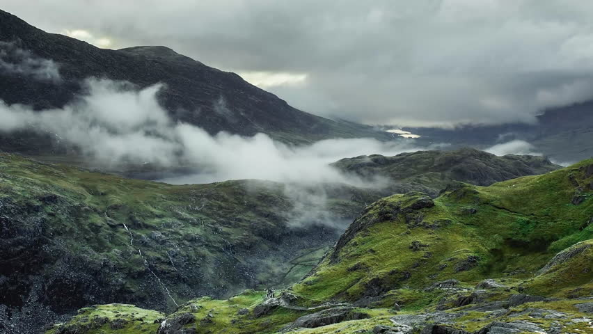 Snowdonia National Park- time lapse of cloud inversions and hikers walking up popular Pyg track on route to the summit of Mount Snowdon