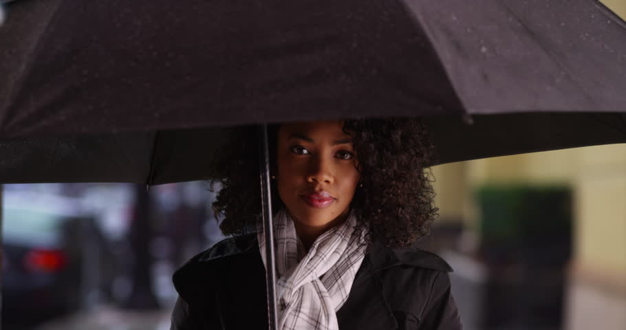 Image result for black woman under umbrella