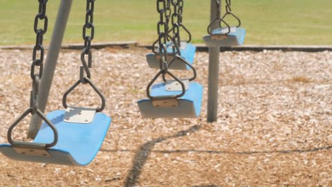 Empty swings at child playground loop