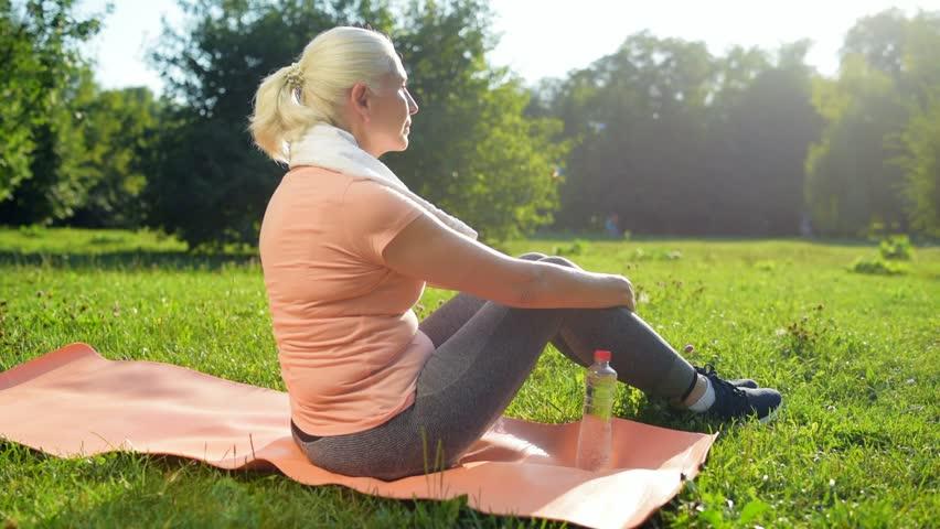 Nica elderly woamn resting after sport activities | Shutterstock HD Video #31035055