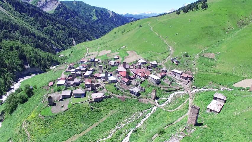 Flying over village Ushguli and Mountain Valley Aerial 4k video. Hiking Travel Tourism Caucasus Svaneti, Georgia.