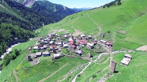 Flying over village Ushguli and Mountain Valley Aerial 4k video. Hiking Travel Tourism Caucasus Svaneti, Georgia.
