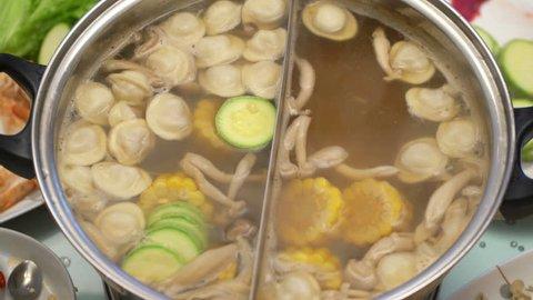 Concept Hotpot Asian cuisine. Cooking shrimp in skimmer spoon. Shrimp in hot soy sauce