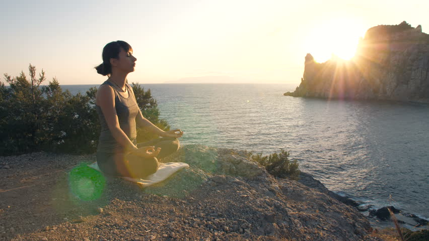 Woman meditates against the sea | Shutterstock HD Video #31045648
