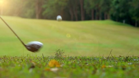Golf slow motion golfer hitting golf ball in tee off area on morning in beautiful golf course. Fairway and layout beauty and player exercise to good health and relaxation stay activity in the holiday.