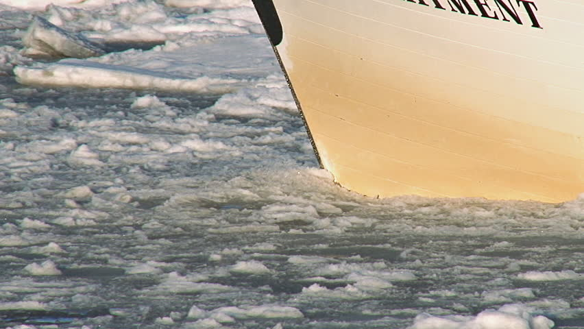 Boats Bow Pushing through Icy Slushy Waters