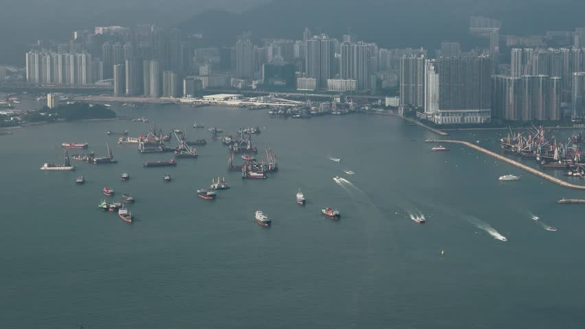 Hong Kong - Elevated view of Victoria Harbour with cargo ships. 4K resolution. September 2017 | Shutterstock HD Video #31060906