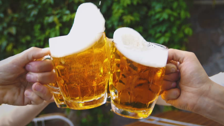 slow motion beer mug toast