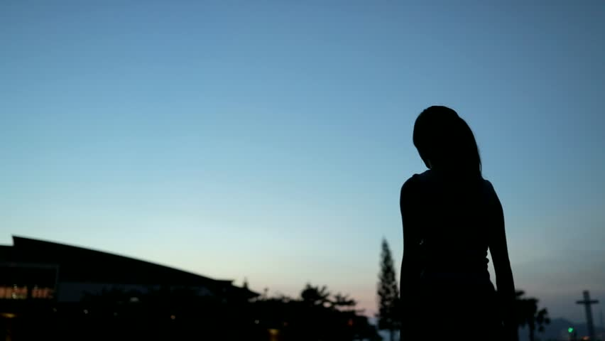 Slow motion of Silhouette excited woman holding shopping bags at sunset time #31078549