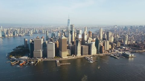 Aerial view of busy New York city in America, Manhattan district on the shore of East river. Drone flies to city centre.