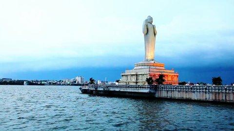 Tracking shot of a statue of Lord Buddha, Hussain Sagar Lake, Hyderabad, Andhra Pradesh, India