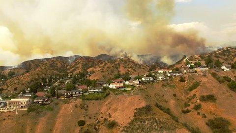Smoky wildfire in California neighborhood