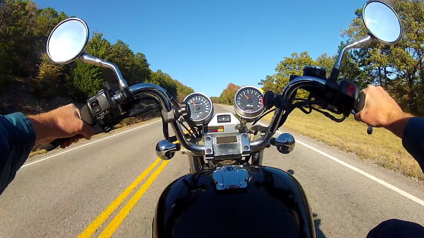 The point of view of a motorcycle rider on a rural road in South Eastern