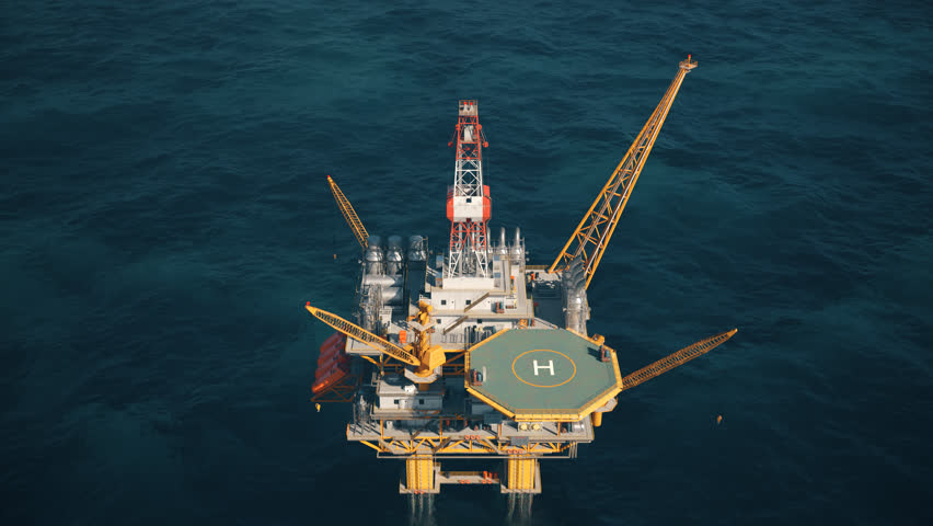 02926 Aerial view of the offshore drilling oil rig in the middle of the sea.