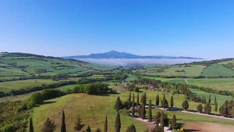 Tuscany aerial landscape of farmland hill country at morning. Italy, Europe, 4k