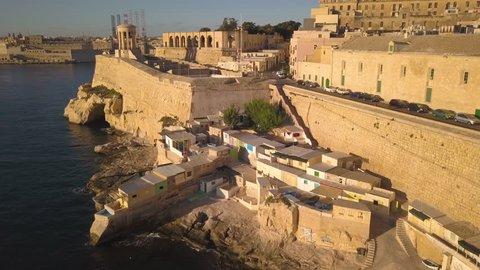 flying over fishing village towards Siege Bell Monument in Valletta Malta