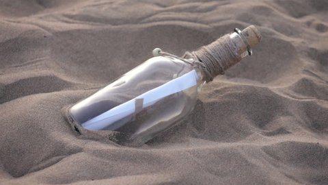 High quality video of message in the bottle in the sand in real 1080p slow motion 250fps