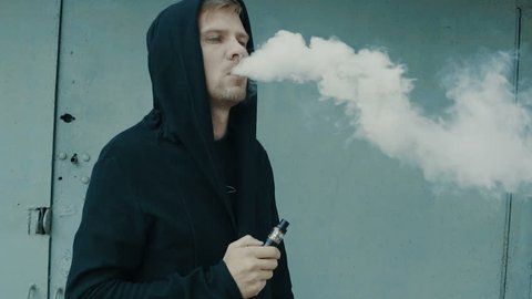 Man smoking electronic cigarette vapor. Smoking Electronic Cigarette, Vape, Man Vaping