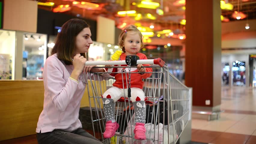 Little child girl eating an Ice Cream Gelato Sour Taste with Mom in Grocery Mall | Shutterstock HD Video #31317997