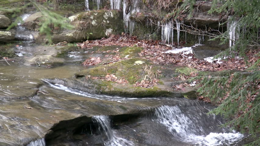 Water Down Mountain with Ice in Background