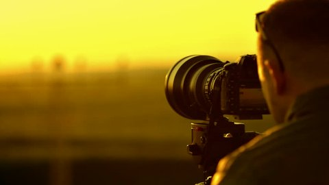 Caucasian Photographer Taking Pictures and Videos. Slow Motion Footage