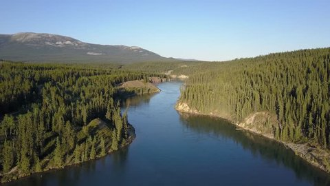 Aerial fly over Miles Canyon Bridge along the Klondike River Yukon