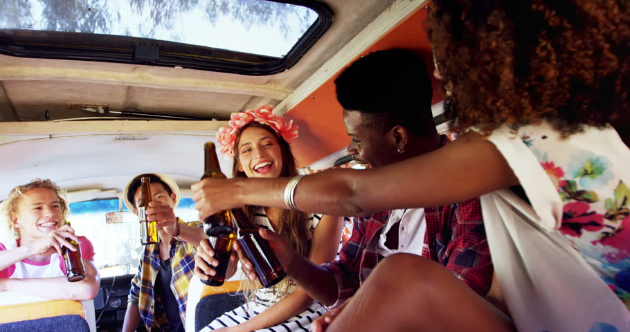 Group of friends toasting beer bottles in van 4k | Shutterstock HD Video #31339486