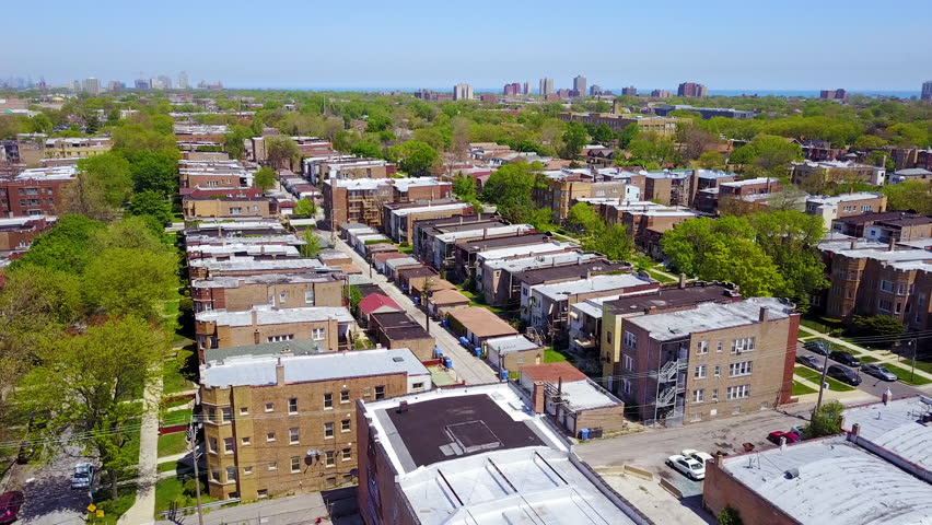 CIRCA 2010s - Chicago - Beautiful aerial around a Moorish dome and lower class neighborhoods on the southside of Chicago.