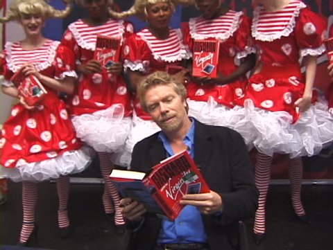 NEW YORK, USA – CIRCA 1998: Billionaire Richard Branson presents and signs the first edition of his autobiography  book 'How I Lost My Virginity', New York, USA circa 1998
